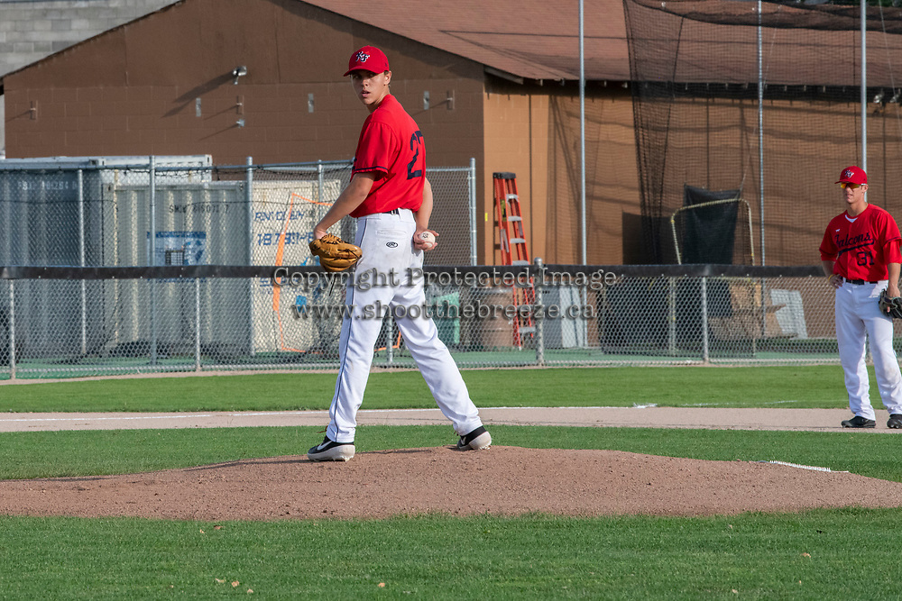 KELOWNA, BC - JULY 17: Zach Jacobs #27 of the Kelowna Falcons stands on the pitcher's mound against the Wenatchee Applesox  at Elks Stadium on July 17, 2019 in Kelowna, Canada. (Photo by Marissa Baecker/Shoot the Breeze)