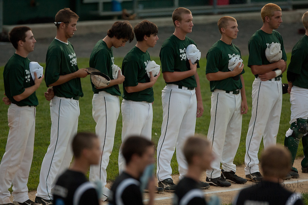 The West Deptford and Pennsylvania teams line up for the National Anthem during the opening round of the Mid-Atlantic Senior League regional tournament held in West Deptford on Friday, August 5.