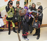 Middletown, New York - A group of people celebrate after winning a costume contest during the Family Fall Festival at the Middletown YMCA on Oct. 23, 2010.