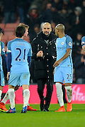 Manchester City manager Josep Guardiola celebrates the 2-0 win over Bournemouth at full time with David Silva (21) of Manchester City and Fernandinho (25) of Manchester City during the Premier League match between Bournemouth and Manchester City at the Vitality Stadium, Bournemouth, England on 13 February 2017. Photo by Graham Hunt.