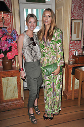 Left to right, CAROLINE HABIB and ALEXANDRA MELNICHENKO at a lunch hosted by Roger Viver in honour of Bruno Frisoni their creative director, held at Harry's Bar, 26 South Audley Street, London on 31st March 2011.
