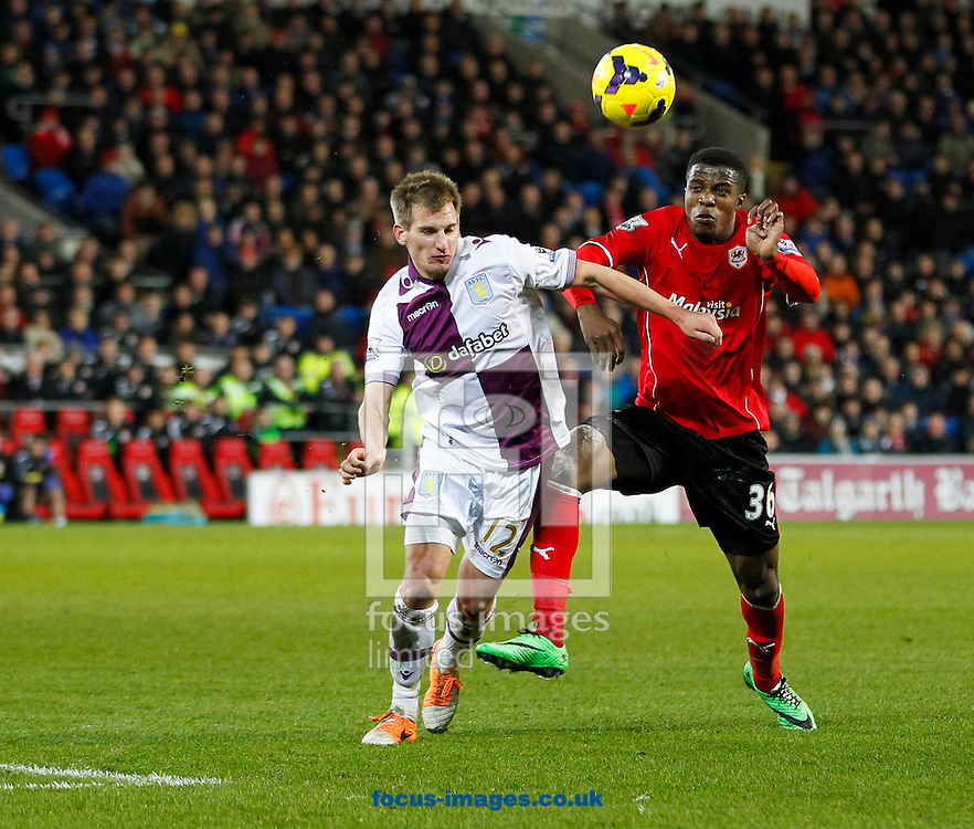 Wifried Zaha of Cardiff City and Marc Albrighton of Aston Villa during the Barclays Premier League match at the Cardiff City Stadium, Cardiff<br /> Picture by Mike  Griffiths/Focus Images Ltd +44 7766 223933<br /> 11/02/2014