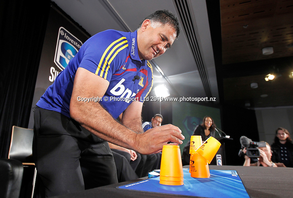 "Jamie Joseph tries his hand at ""Speed Stacking"". 2011 Investec Super 15 New Zealand franchises rugby squad naming, Eden Park, Auckland, Wednesday 10 November 2010. Photo: Simon Watts/photosport.co.nz"