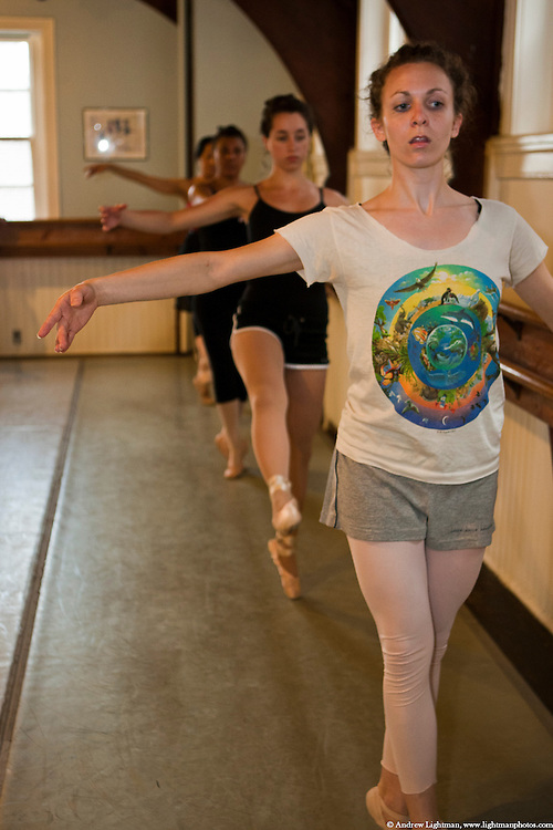 A ballerina at St. Mark's Dance Studio works out at the bar.