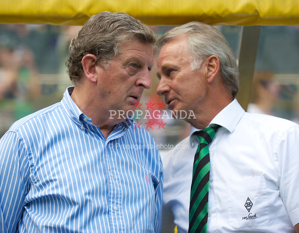 MONCHENGLADBACH, GERMANY - Sunday, August 1, 2010: Borussia Monchengladbach's vice-president Rainer Bonhof with Liverpool's manager Roy Hodgson before a preseason friendly match at Borussia-Park. (Pic by David Rawcliffe/Propaganda)