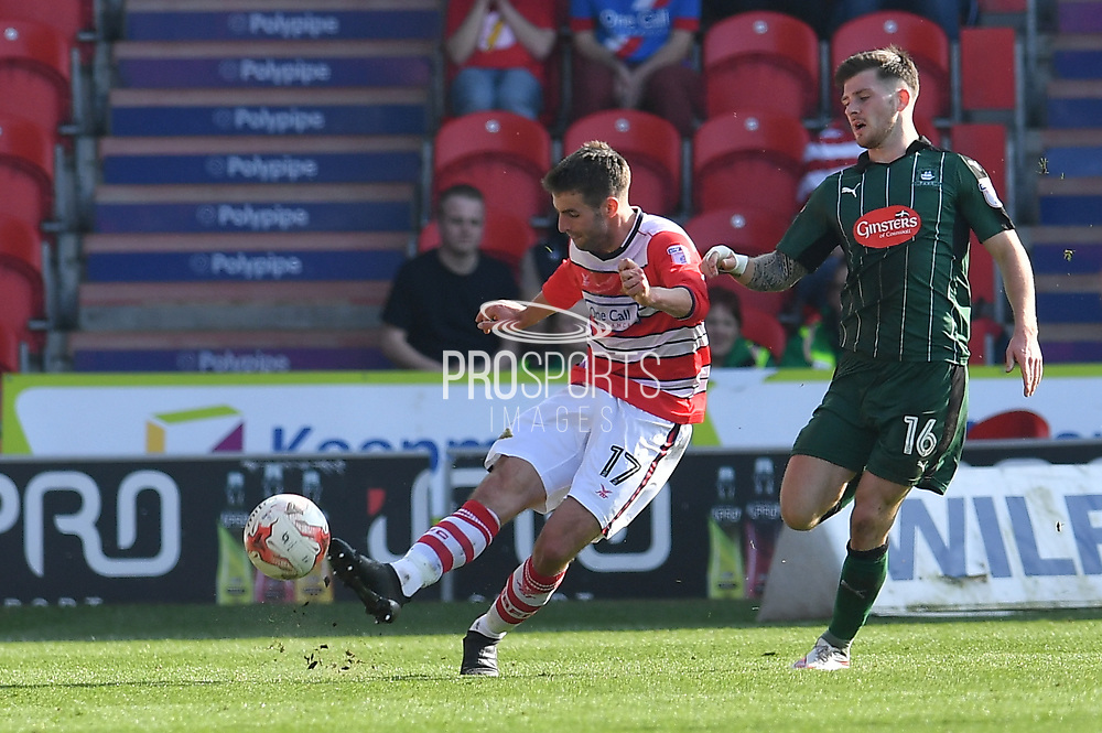 Matty Blair (17) Doncaster Rovers midfielder and Plymouth Argyle midfielder Matthew Kennedy (16) during the EFL Sky Bet League 2 match between Doncaster Rovers and Plymouth Argyle at the Keepmoat Stadium, Doncaster, England on 26 March 2017. Photo by Ian Lyall.