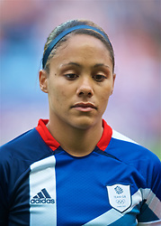 COVENTRY, ENGLAND - Friday, August 3, 2012: Great Britain's Alex Scott lines-up for the national anthems during the Women's Football Quarter-Final match between Great Britain and Canada, on Day 7 of the London 2012 Olympic Games at the Rioch Arena. Canada won 2-0. (Photo by David Rawcliffe/Propaganda)