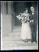 just married couple in front of church doors France circa 1930s