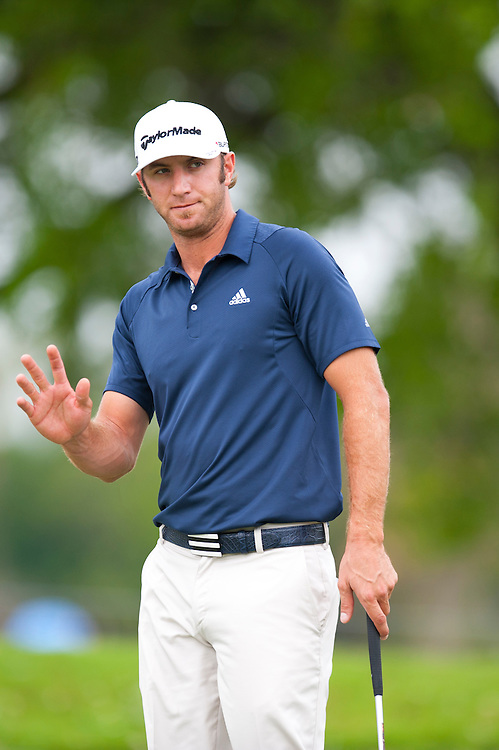 DORAL, FL - MARCH 10: Dustin Johnson looks on during the first round of the WGC-Cadillac Championship at the TPC Blue Monster at the Doral Golf Resort and Spa on March 10, 2011 in Doral, Florida. (Photo by Rob Tringali)  *** Local Caption *** Dustin Johnson