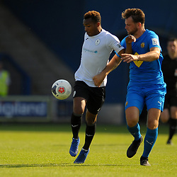 TELFORD COPYRIGHT MIKE SHERIDAN Marcus Dinanga holds off Jack Lane during the National League North fixture between AFC Telford United and Leamington AFC at the New Bucks Head on Monday, August 26, 2019<br /> <br /> Picture credit: Mike Sheridan<br /> <br /> MS201920-005