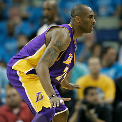 April 28, 2011; New Orleans, LA, USA; Los Angeles Lakers shooting guard Kobe Bryant (24) against the New Orleans Hornets during the second quarter in game six of the first round of the 2011 NBA playoffs at the New Orleans Arena.    Mandatory Credit: Derick E. Hingle