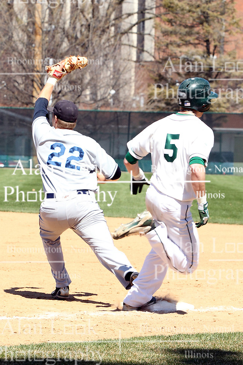 14 April 2013:  Tim Coonan is out at 1st base on the ball caught by Luke Collins during an NCAA division 3 College Conference of Illinois and Wisconsin (CCIW) Baseball game between the Elmhurst Bluejays and the Illinois Wesleyan Titans in Jack Horenberger Stadium, Bloomington IL