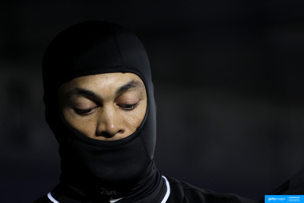 NEW YORK, NEW YORK - APRIL 12: On a bitterly cold evening in New York, Giancarlo Stanton, Miami Marlins, wears a head mask for warmth as he tries to keep warm in the dugout before batting during the Miami Marlins Vs New York Mets MLB regular season ball game at Citi Field on April 12, 2016 in New York City. (Photo by Tim Clayton/Corbis via Getty Images)
