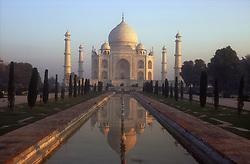 Taj Mahal at Agra; India; at dawn with reflection in pool,