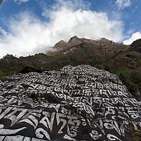 A big mani stone between Lukla and Phakding.