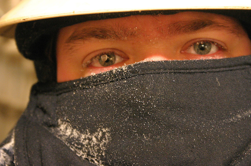 Alaska.  North Slope.  Prudhoe Bay.  Portrait of oilfield worker coming in from the cold.