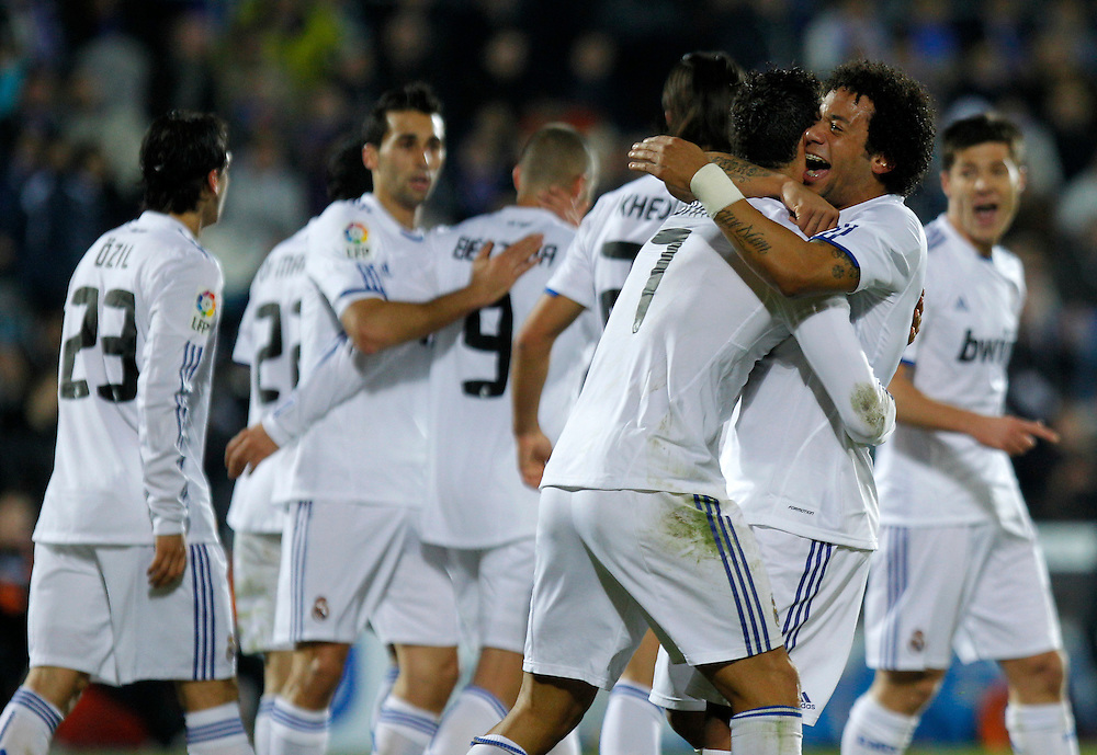 Real Madrid's Cristiano Ronaldo from Portugal, 3rd right, reacts after scoring against Getafe with Marcelo from Brazil, 2nd right, during their La Liga soccer match at the Coliseum Alfonso Perez stadium in Getafe, near Madrid, on Monday, Jan. 3, 2011.