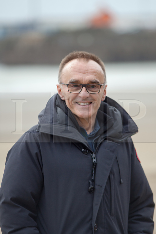 @Licensed to London News Pictures 11/11/2018. Folkestone, Kent. Film director Danny Boyle addresses the media and remembers the 100th anniversary of Armistice Day in Folkestone. Members of the public are invited to create sand silhouettes of soldiers in memory of loved ones on Sunny Sands in Folkestone today. Hollywood director Danny Boyle has also  curated huge portraits on 32 beaches across the nation to mark the centenary of the World War One Armistice. Photo credit: Manu Palomeque/LNP