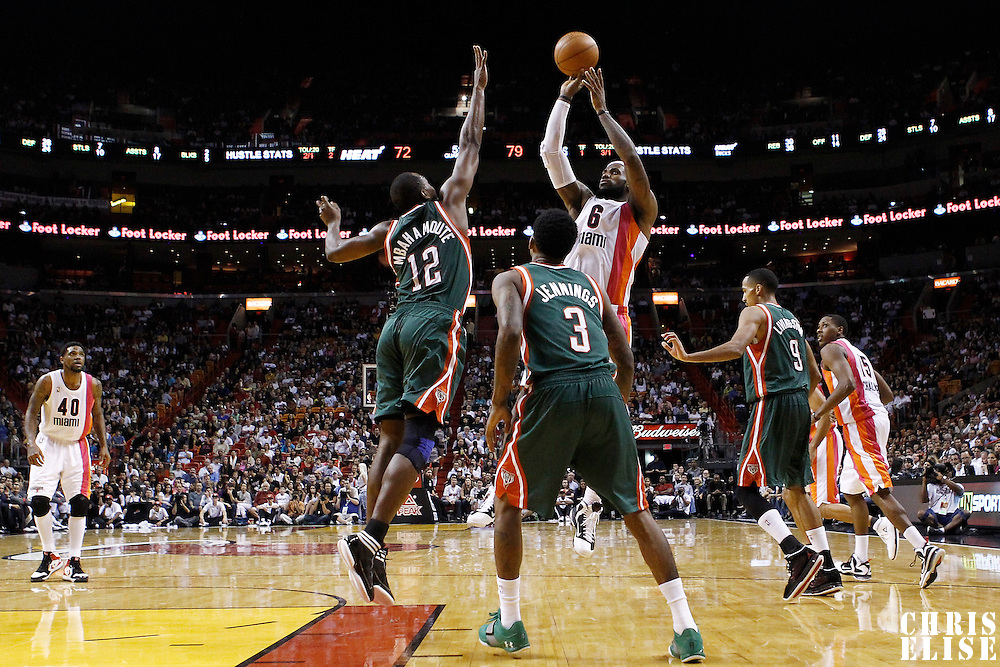 22 January 2012: Miami Heat small forward LeBron James (6) takes a jumpshot over Milwaukee Bucks small forward Luc Richard Mbah a Moute (12) during the Milwaukee Bucks 91-82 victory over the Miami Heat at the AmericanAirlines Arena, Miami, Florida, USA.