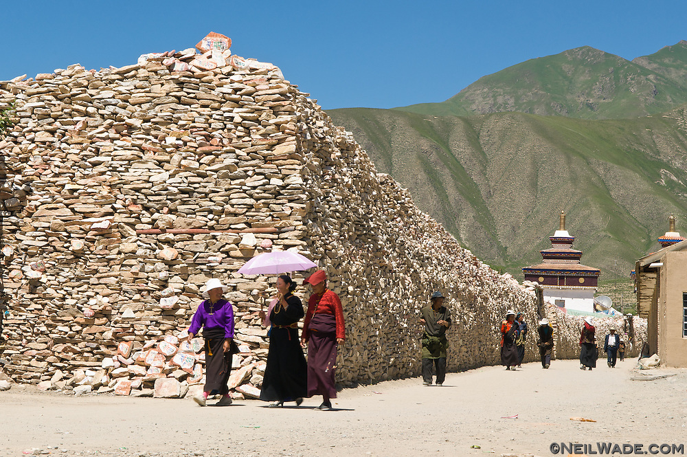 Tibetan Buddhists walk around the Jiana (Gyanak) Mani stone pile in Yushu, Tibet.