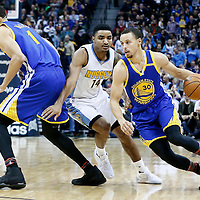 13 February 2017: Golden State Warriors guard Stephen Curry (30) drives past Denver Nuggets guard Gary Harris (14) on a screen set by Golden State Warriors center JaVale McGee (1) during the Denver Nuggets 132-110 victory over the Golden State Warriors, at the Pepsi Center, Denver, Colorado, USA.