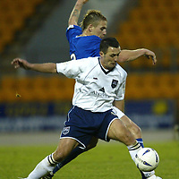 St Johnstone v Ross County....06.12.03<br />David Hannah holds odd Ryan Stevenson<br /><br />Picture by Graeme Hart.<br />Copyright Perthshire Picture Agency<br />Tel: 01738 623350  Mobile: 07990 594431