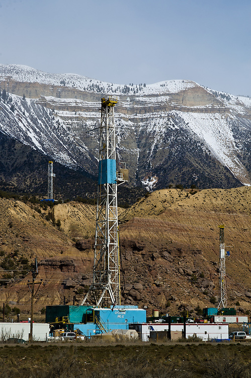 Gas exploration drilling rigs beneath the Roan Ciffs, Colorado