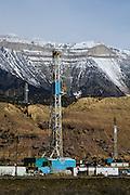 Gas exploration drilling rigs beneath the Roan Ciffs, Colorado
