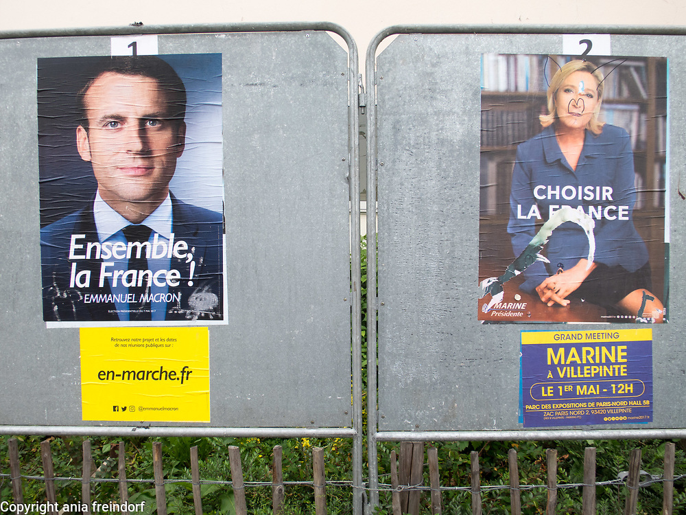 Presidential elections in France, 2017, Emmanuel Macron 65.5% wins French presidential election, defeating Marine le Pen 34.5%, poster of Marine Le Pen and Emmanuel Macron