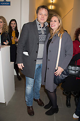 Actor SHAUN DOOLEY and his wife POLLY at the opening of the exhibition Champagne Life in celebration of 30 years of The Saatchi Gallery, held on 12th January 2016 at The Saatchi Gallery, Duke Of York's HQ, King's Rd, London.