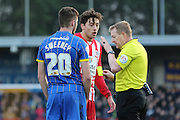 referee Dean Whitestone deals with the confrontation between Matt Crooks of Accrington Stanley FC and Ryan Sweeney of AFC Wimbledon during the Sky Bet League 2 match between AFC Wimbledon and Accrington Stanley at the Cherry Red Records Stadium, Kingston, England on 5 March 2016. Photo by Stuart Butcher.