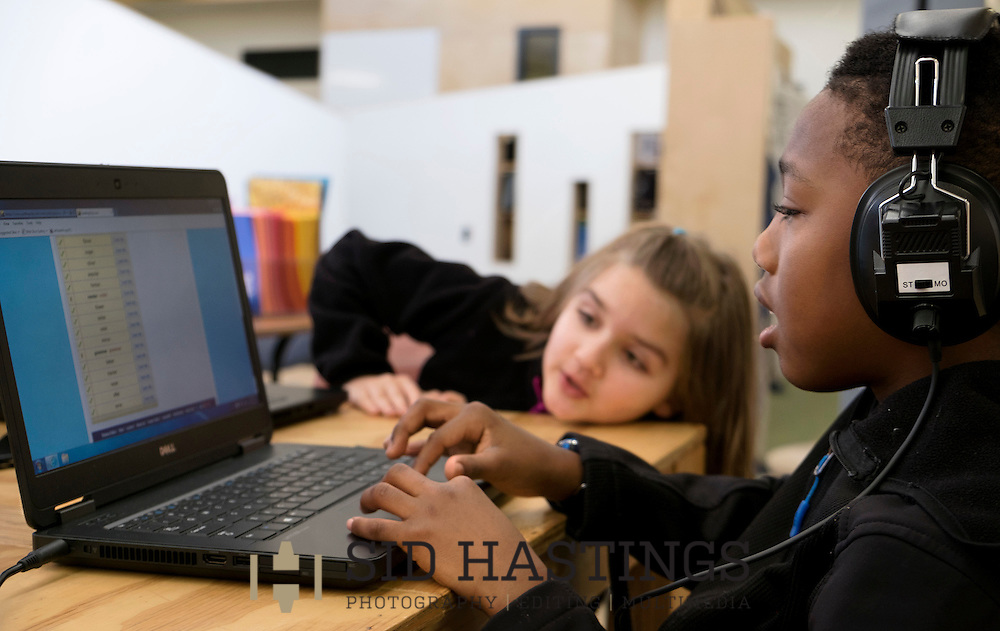 29 Feb. 2016 -- ST. LOUIS -- City Garden Montessori School students Derrick Patrick (right) and Mikayla Hunsberger, students in the &quot;The Crew of 321,&quot; work on a computer-based spelling test during class at the school in St. Louis Monday, Feb. 29, 2016. According to Dr. Nicole Evans, City Garden principal, the class includes students who in a traditional school would be in first, second and third grades. City officials report that success of the school, which serves students in the Shaw, Botanical Heights, Forest Park Southeast, Tiffany and Southwest Garden neighborhoods, has resulted in expanded home renovation and construction in some of the neighborhoods served.<br /> <br /> Photo &copy; copyright 2016 Sid Hastings.
