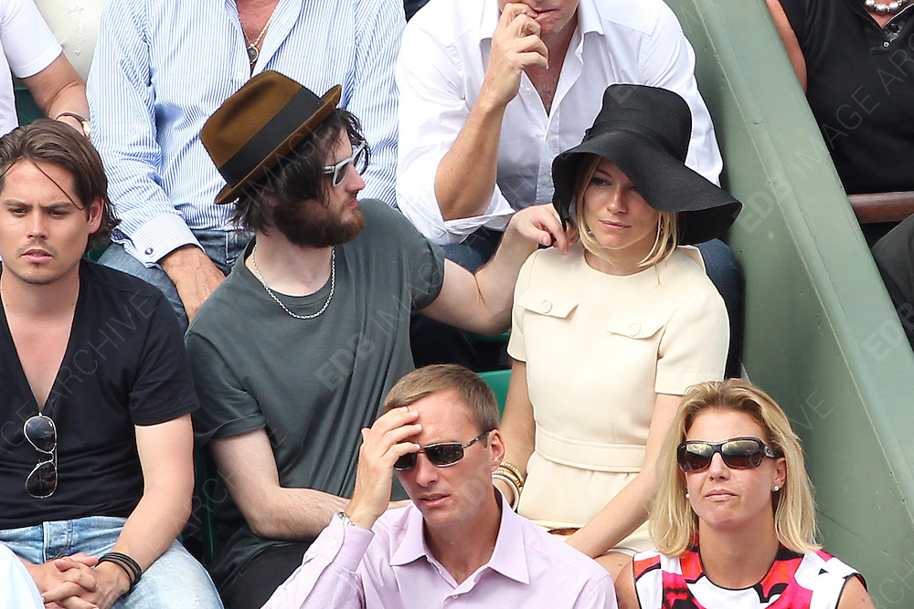 05.JUNE.2011. PARIS<br /> <br /> SIENNA MILLER AND TOM STURRIDGE AT THE TENNIS FRENCH OPEN 2011 MENS FINAL AT ROLAND GARROS, PARIS.<br /> <br /> BYLINE: EDBIMAGEARCHIVE.COM<br /> <br /> *THIS IMAGE IS STRICTLY FOR UK NEWSPAPERS AND MAGAZINES ONLY*<br /> *FOR WORLD WIDE SALES AND WEB USE PLEASE CONTACT EDBIMAGEARCHIVE - 0208 954 5968*