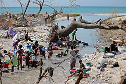 October 9, 2016 - HTI - People bathe and clean clothes in a river cutting through Roche a Bateau, Haiti on Sunday, Oct. 9, 2016. (Credit Image: © Patrick Farrell/TNS via ZUMA Wire)