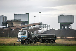 © Licensed to London News Pictures. 17/12/2015. Kellingley UK. A coal lorry leaves Kellingley Colliery in Yorkshire as Britain's last deep coal mine prepares to close down tomorrow (friday 18th December) with the loss of 450 jobs. Photo credit: Andrew McCaren/LNP