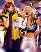 "Pop music star Britney Spears (R) and rock star Steve Tyler (L) from the band ""Aerosmith"" perform during the halftime show at Super Bowl XXXV in Tampa, Florida. January 28, 2001. Colin Braley/Stock"