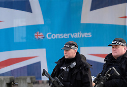 (c) Licensed to London News Pictures. <br /> 03/10/2017<br /> Manchester, UK<br /> <br /> Armed police officers patrol the grounds at the Conservative Party Conference held at the Manchester Central Convention Complex.<br /> <br /> Photo Credit: Ian Forsyth/LNP