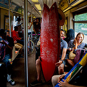 QUEENS, N.Y. - JULY 2, 2015: Shaun Elabd of Los Angeles and his girlfriend Katie Burrell of Chinatown, head on the A train toward Rockaway Beach on a Thursday before the long Fourth of July holiday weekend. CREDIT: Sam Hodgson for The New York Times