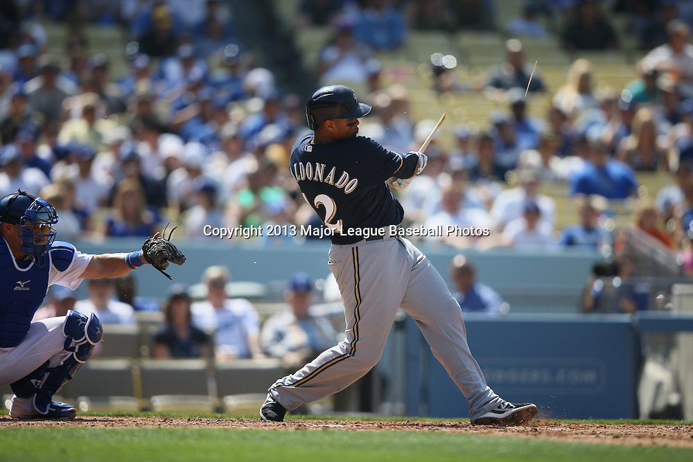 LOS ANGELES, CA - APRIL 28:  Martin Maldonado #12 of the Milwaukee Brewers bats during the game against the Los Angeles Dodgers on Sunday, April 28, 2013 at Dodger Stadium in Los Angeles, California. The Dodgers won the game 2-0. (Photo by Paul Spinelli/MLB Photos via Getty Images) *** Local Caption *** Martin Maldonado