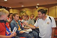 23-08-2008 VOETBAL:WILLEM II:OPENDAG:TILBURG<br /> Perschef Rene Vermetten houdt de microfoon bij een van de jonge supporters tijdens de persconferentie op de koningsdag<br /> Foto: Geert van Erven