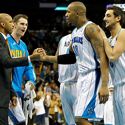 January 24,  2011; New Orleans, LA, USA; New Orleans Hornets power forward David West (30) celebrates with teammates after scoring the game winning basket against the Oklahoma City Thunder during the fourth quarter at the New Orleans Arena. The Hornets defeated the Thunder 91-89. Mandatory Credit: Derick E. Hingle