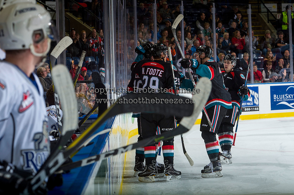 KELOWNA, CANADA - OCTOBER 4: Kole Lind #16, Kyle Topping #24, Gordie Ballhorn #4 and Nolan Foote #29 of the Kelowna Rockets celebrate a goal at the boards against the Victoria Royals on October 4, 2017 at Prospera Place in Kelowna, British Columbia, Canada.  (Photo by Marissa Baecker/Shoot the Breeze)  *** Local Caption ***