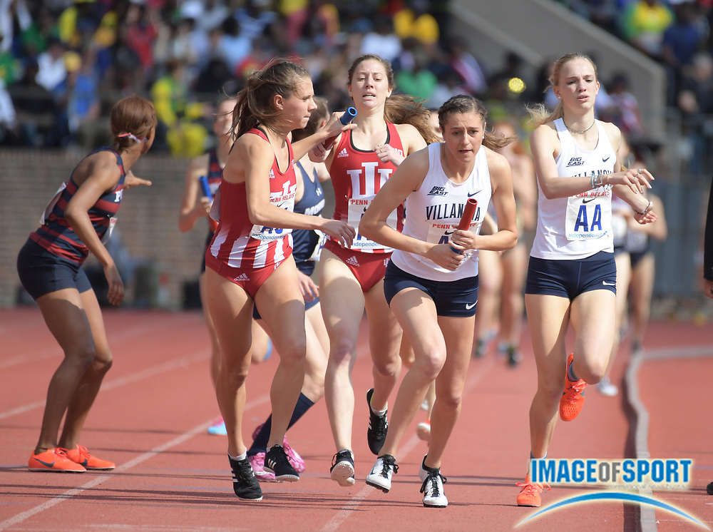 Apr 28, 2018; Philadelphia, PA, USA; McKenna Keegan takes the handoff from Rachel McArthur on the third leg of the Villanova women's 4 x 800m relay that won the Championship of America race in 8:19.98 during the 124th Penn Relays at Franklin Field.