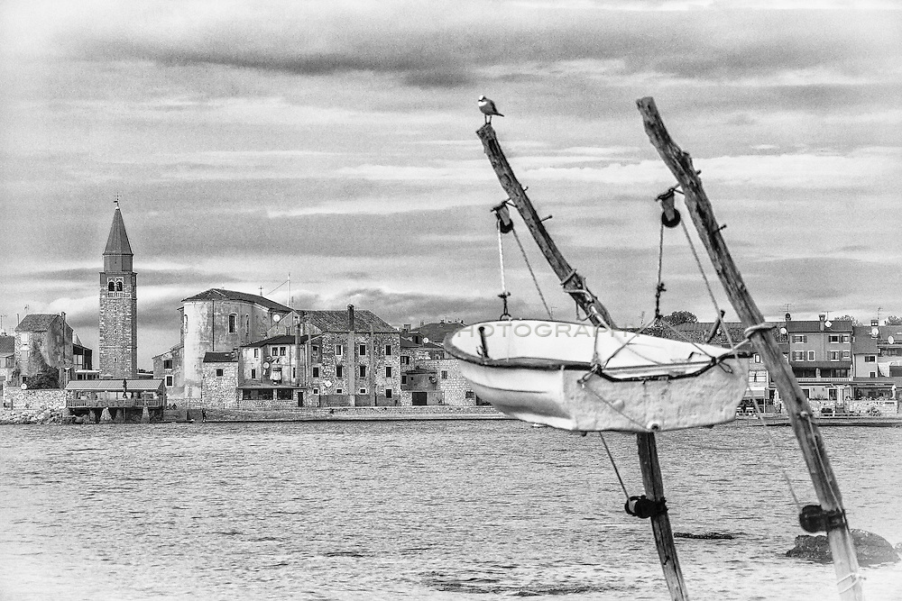 Umag, Istria, Croatia, boat hanging, bird on pole, town square, boat