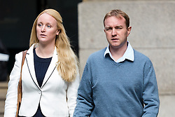 © Licensed to London News Pictures. 30/07/2015. London, UK. Former trader, TOM HAYES  with his wife, Sarah arrive at Southwark Crown Court in London. Hayes appears charged with eight counts of conspiracy to defraud in relation to alleged manipulation and rigging of the global Libor interest rate. The jury has retired to consider its verdict. Photo credit : Vickie Flores/LNP