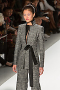 Gray pants and matching jacket with a satin tie at the waist. By Zang Toi, shown at his Spring 20132 Fashion Week show in New York.