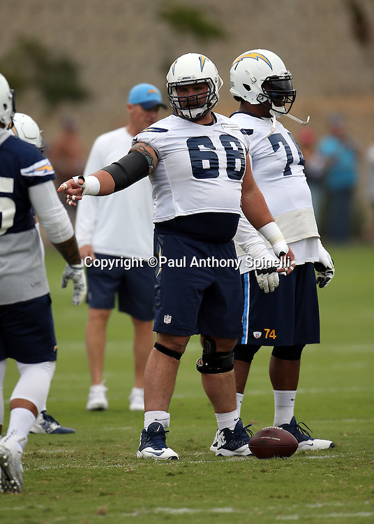 San Diego Chargers center Matt Slauson (68) points at the defense as he gets set over the ball during the Chargers 2016 NFL minicamp football practice held on Tuesday, June 14, 2016 in San Diego. (©Paul Anthony Spinelli)