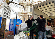 © Licensed to London News Pictures. 23/02/2012, London, UK. Two protesters load a van with belongings from the site. Protesters start to pack up at the Occupy London Stock Exchange site in front of St Paul's Cathedral on February 23rd 2012. Protesters at the site have been refused permission to appeal against their eviction from the Occupy London camp.. Photo credit : Stephen Simpson/LNP