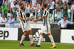 August 19, 2017 - Turin, Piedmont, Italy - Gonzalo Higuain (Juventus FC) celebrates after scoring with Giorgio Chiellini during the Serie A football match between Juventus FC and Cagliari Calcio at Allianz Stadium on august 19, 2017 in Turin, Italy. (Credit Image: © Massimiliano Ferraro/NurPhoto via ZUMA Press)