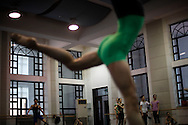 Dancers from the National Ballet of China rehearse at the their studio in Beijing, China, Friday, Aug. 21, 2009.  For Chinese, ballet is tangled up with China's blood-soaked revolutionary past, arriving here in the 1950s on a wave of pro-Soviet fervor and quickly repurposed as a propaganda weapon during the Cultural Revolution.